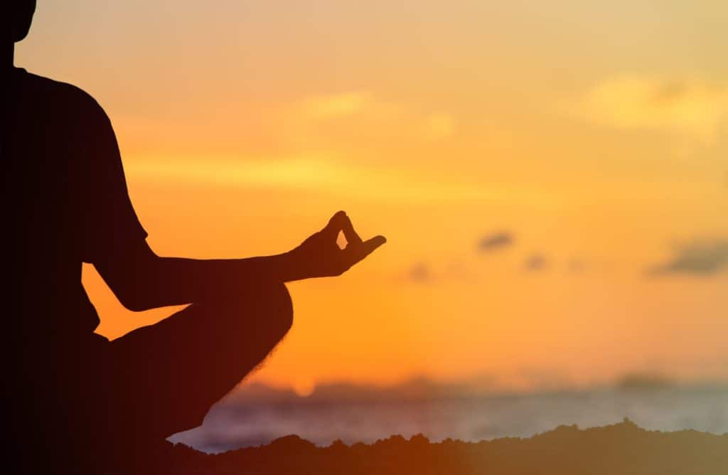 42635030 - serenity and yoga practicing at sunset, meditation